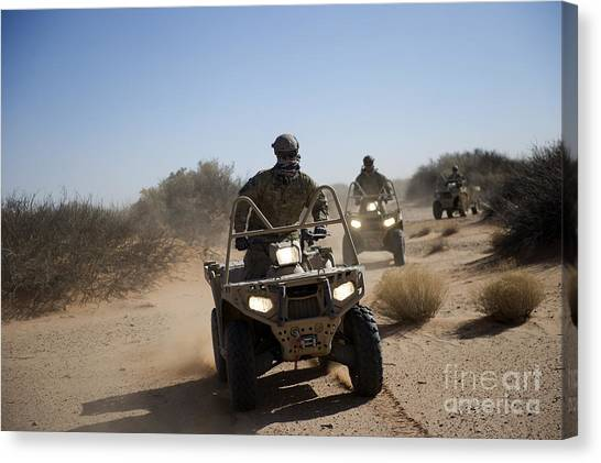 Green Berets Canvas Print - A U.s. Soldier Performs Off-road by Stocktrek Images