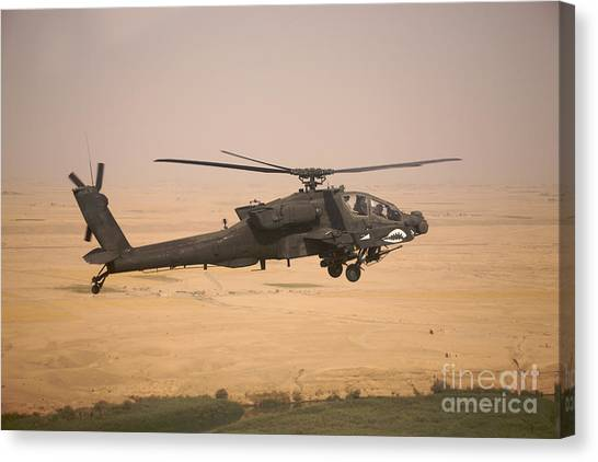 Iraq Canvas Print - Ah-64d Apache Helicopter On A Mission by Terry Moore