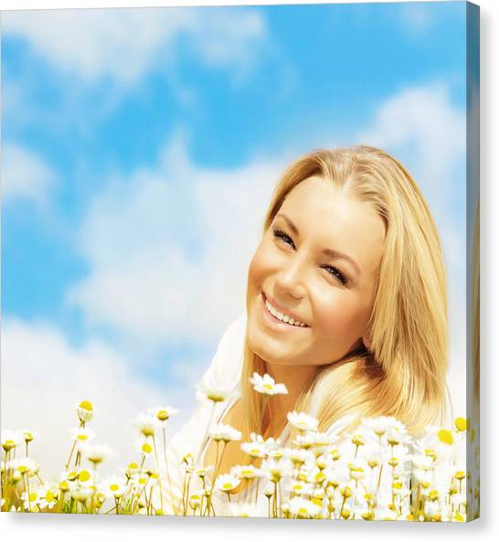 Beautiful Woman Enjoying Daisy Field And Blue Sky Canvas Print