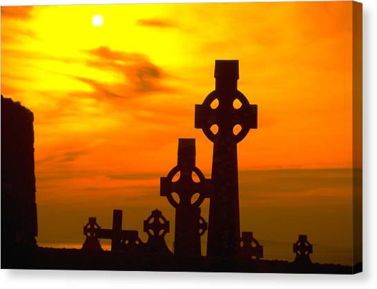 Celtic Crosses In Sunset Canvas Print by Carl Purcell