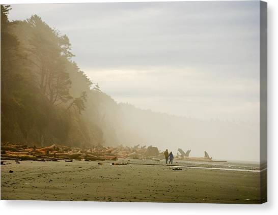 Couple On A Foggy Beach Canvas Print by Wilbur Young