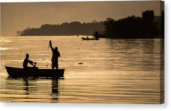 Net Fishing At Sunset Canvas Print by Dane Strom