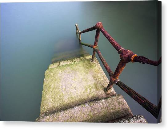 Rusty Handrail Going Down On Water Canvas Print