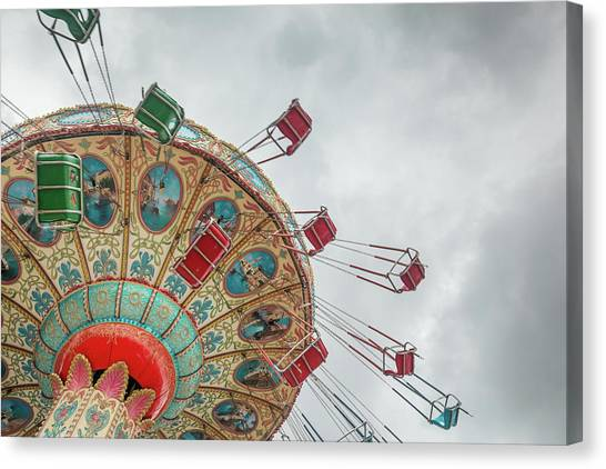 Swings In Motion With Stormy Sky Canvas Print by Erin Cadigan