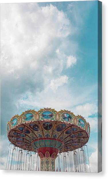 Swings With Stormy Sky Canvas Print by Erin Cadigan