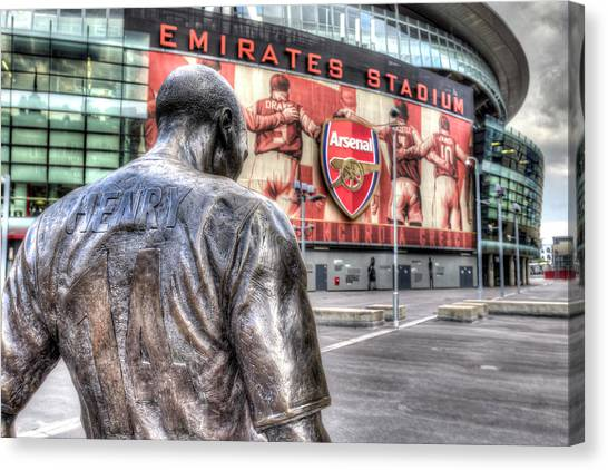 Arsenal Fc Canvas Print - Thierry Henry Statue Emirates Stadium by David Pyatt