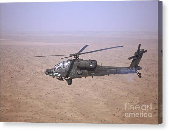Iraq Canvas Print - An Ah-64d Apache Longbow Fires A Hydra by Terry Moore