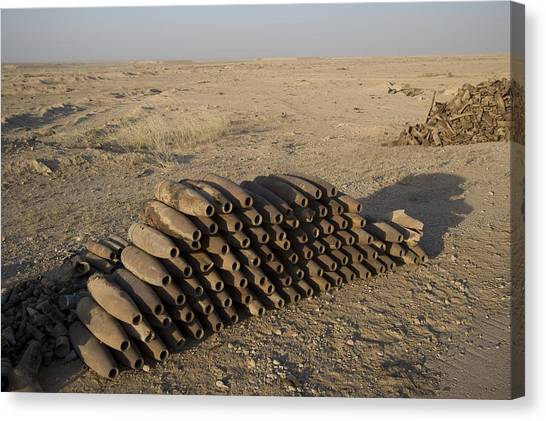 Warheads Canvas Print - Inert Artillery Shells Are Stacked by Terry Moore