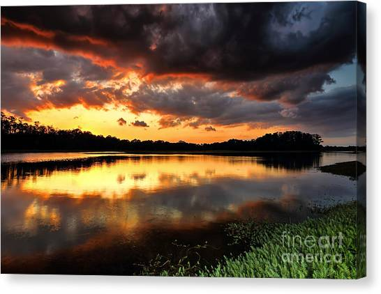 Sunset Reflections Canvas Print by Rick Mann