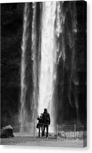 Seljalandsfoss Canvas Print - tourists pose for photographs in front of Seljalandsfoss waterfall iceland by Joe Fox