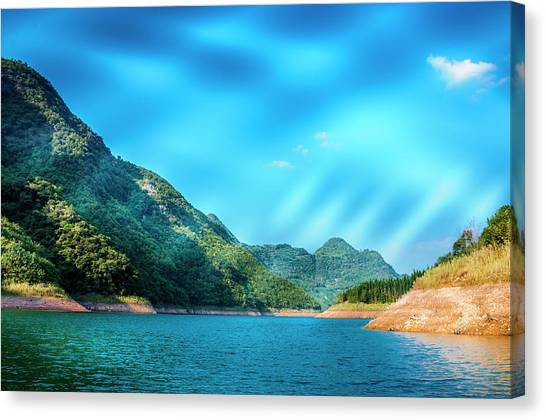 The Mountains And Reservoir Scenery With Blue Sky Canvas Print