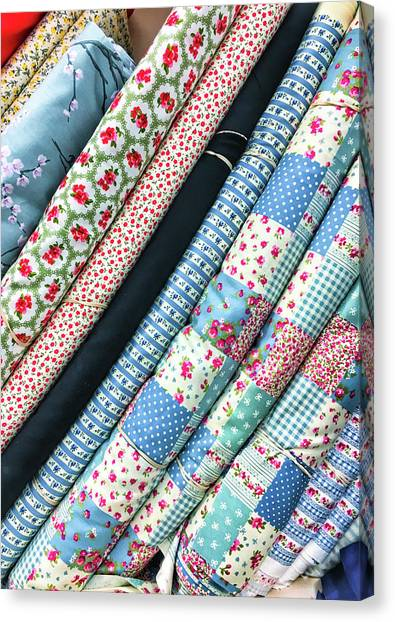 Clothing Store Canvas Print - Rolls Of Fabric by Tom Gowanlock