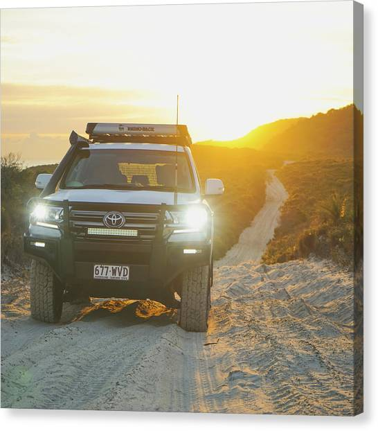 4wd Car Explores Sand Track In Early Morning Light Canvas Print