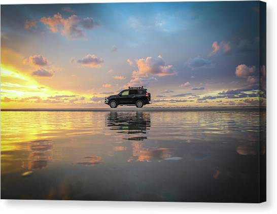 4wd Vehicle And Stunning Sunset Reflections On Beach Canvas Print