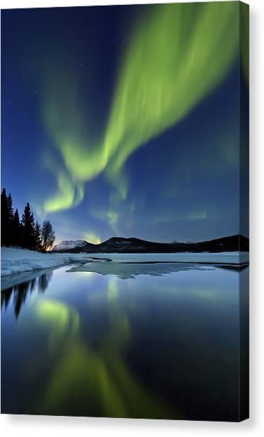 Canvas Print featuring the photograph Aurora Borealis Over Sandvannet Lake by Arild Heitmann