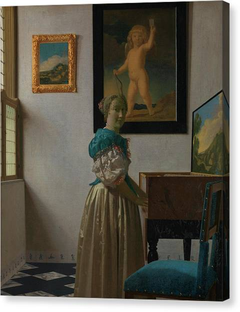 Harpsichords Canvas Print - A Young Woman Standing At A Virginal by Johannes Vermeer