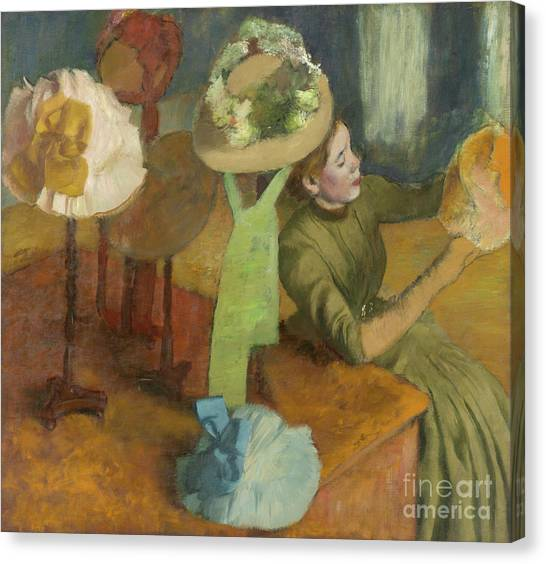 Edgar Degas Canvas Print - The Millinery Shop by Edgar Degas