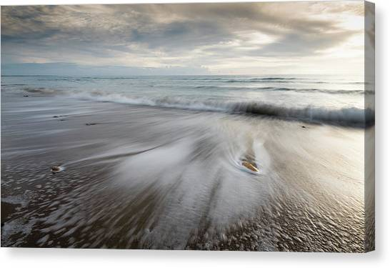 Pebbles In The Beach And Flowing Sea Water Canvas Print
