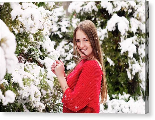 Beautiful Young Girl Model In Winter In A Parked Park. In A Red Sweater. Canvas Print by Oleksandr Masnyi