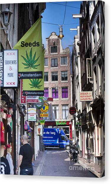 Streets Of Amsterdam Canvas Print by Andre Goncalves