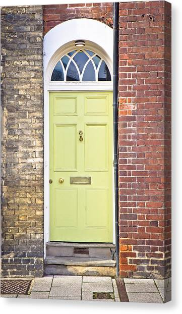 Brick Sidewalks Canvas Print - Yellow Door by Tom Gowanlock