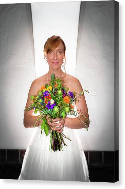 A Beautiful Backlit Bride And Her Bouquet Canvas Print