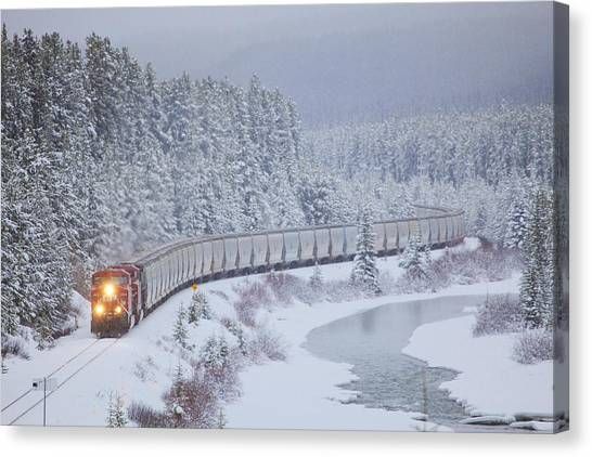 Trains Canvas Print - A Canadian Pacific Train Travels Along by Chris Bolin