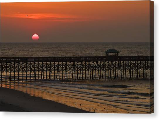 A Charleston Sunrise On The Pier Canvas Print by Michael Whitaker