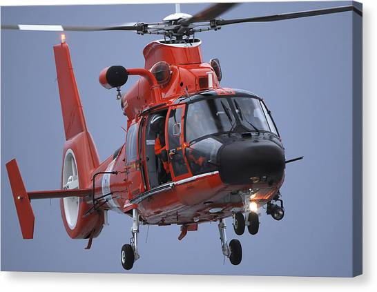 Medivac Canvas Print - A Coast Guard Mh-65 Dolphin Helicopter by Stocktrek Images