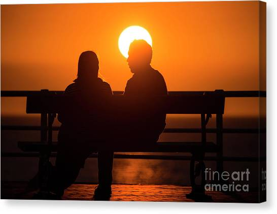 A Couple Sitting At Sunset Canvas Print