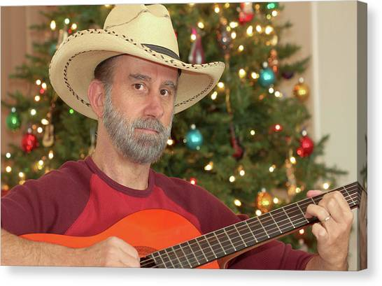 Classical Guitars Canvas Print - A Cowboy With A Guitar By A Christmas Tree by Derrick Neill