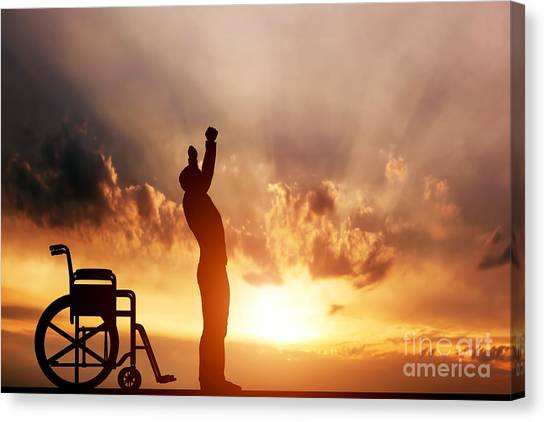 A Disabled Man Standing Up From Wheelchair Canvas Print
