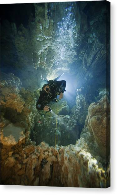 Underwater Caves Canvas Print - A Diver Ascends A Deep Shaft In Dans by Wes C. Skiles