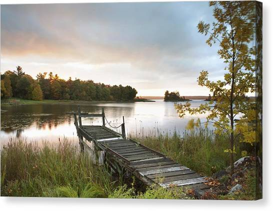 Susan Canvas Print - A Dock On A Lake At Sunrise Near Wawa by Susan Dykstra