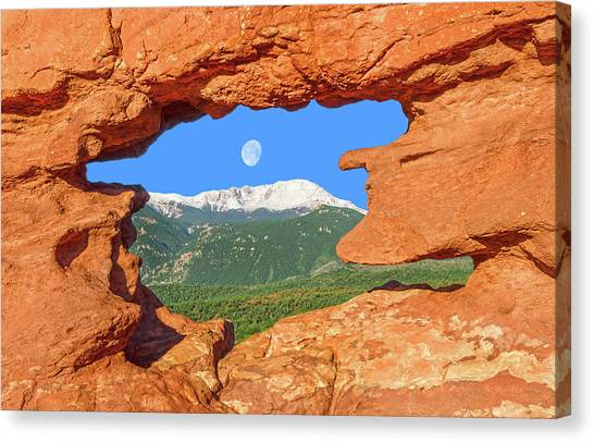 A Glimpse Of The Mighty Rockies Through A Rocky Window  Canvas Print