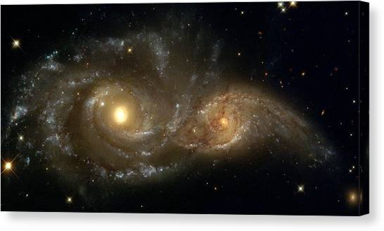 A Grazing Encounter Between Two Spiral Galaxies Canvas Print