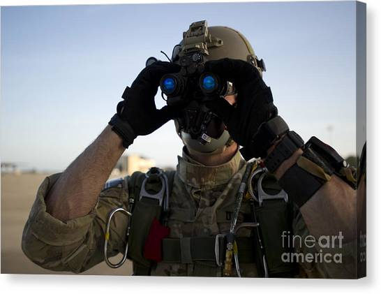 Green Berets Canvas Print - A Green Beret Checks Attached Night by Stocktrek Images