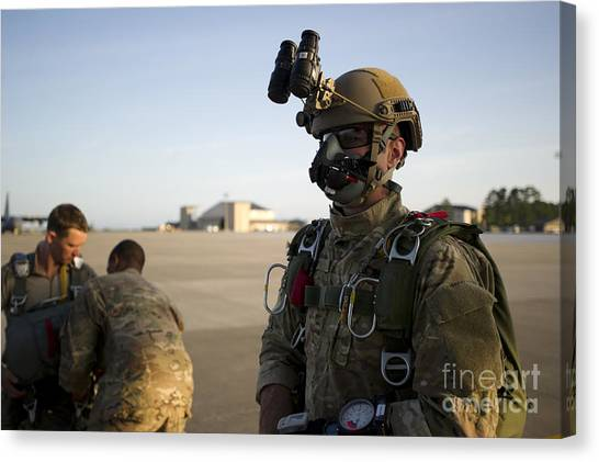 Green Berets Canvas Print - A Green Beret Waits To Have His Gear by Stocktrek Images