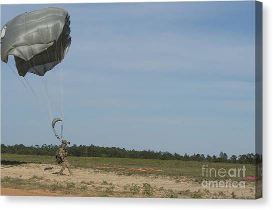 Green Berets Canvas Print - A Halo Jumper Lands On The Landing Zone by Stocktrek Images