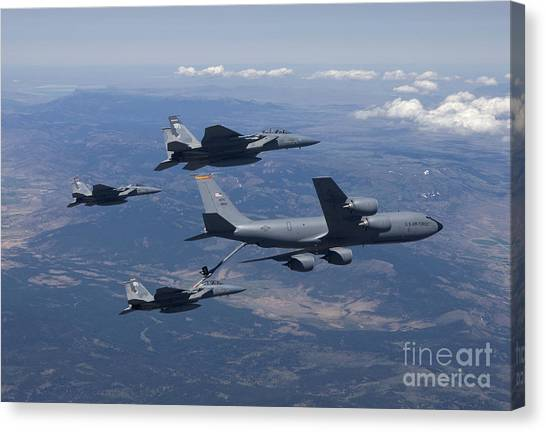 Eagle In Flight Canvas Print - A Kc-135r Stratotanker Refuels Three by HIGH-G Productions