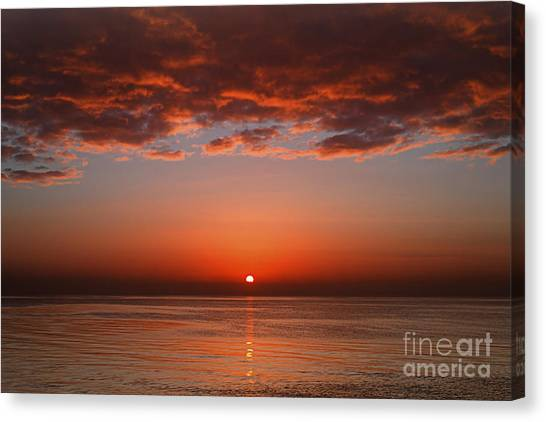 Sunrise Horizon Canvas Print - A Layer Of Clouds Is Lit By The Rising by Luis Argerich