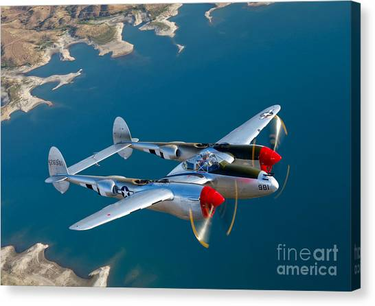 Shoulders Canvas Print - A Lockheed P-38 Lightning Fighter by Scott Germain