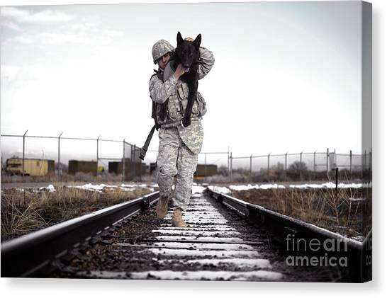A Military Dog Handler Uses An Canvas Print