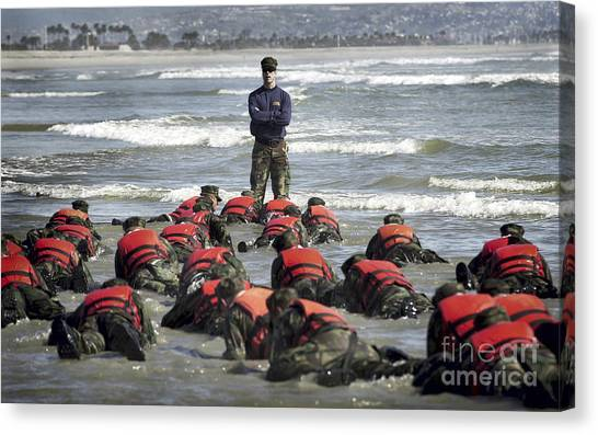 Navy Seal Canvas Print - A Navy Seal Instructor Assists Students by Stocktrek Images