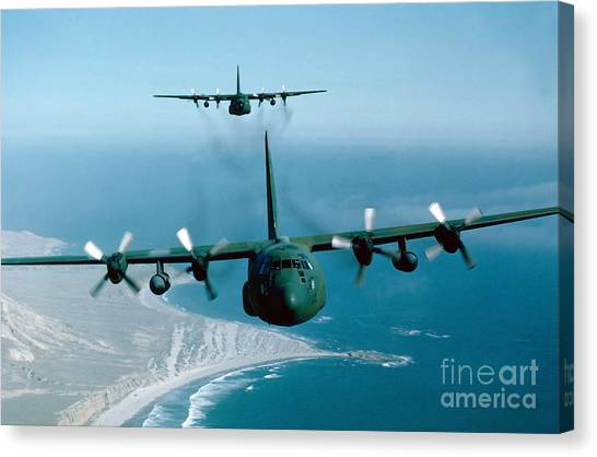 Canvas Print featuring the photograph A Pair Of C-130 Hercules In Flight by Stocktrek Images