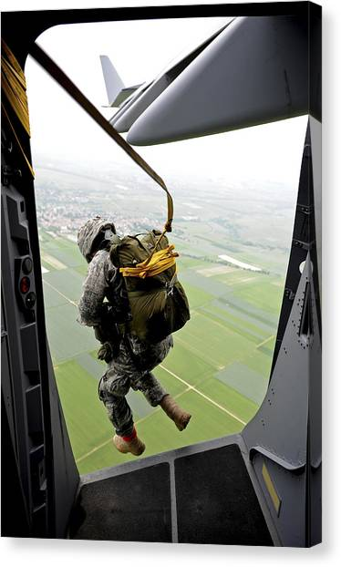 Skydiving Canvas Print - A Paratrooper Executes An Airborne Jump by Stocktrek Images