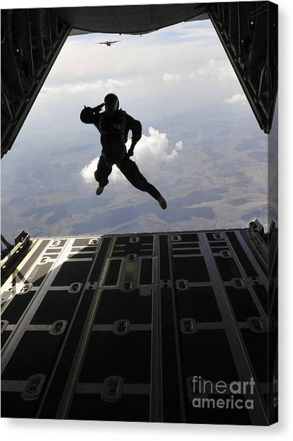 Skydiving Canvas Print - A Paratrooper Salutes As He Jumps by Stocktrek Images