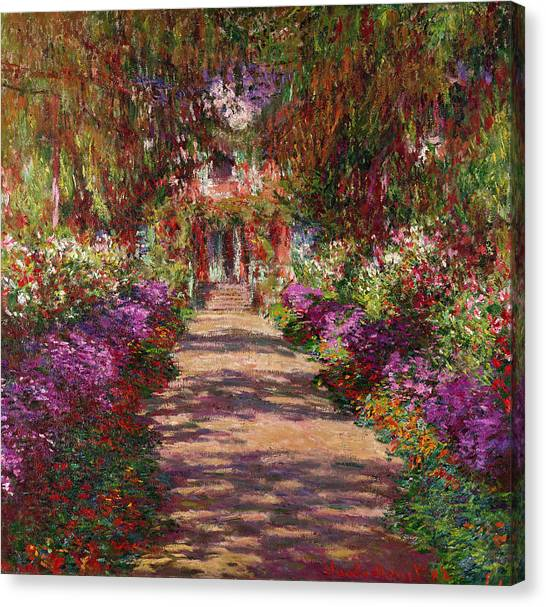 Garden Flowers Canvas Print - A Pathway In Monets Garden Giverny by Claude Monet