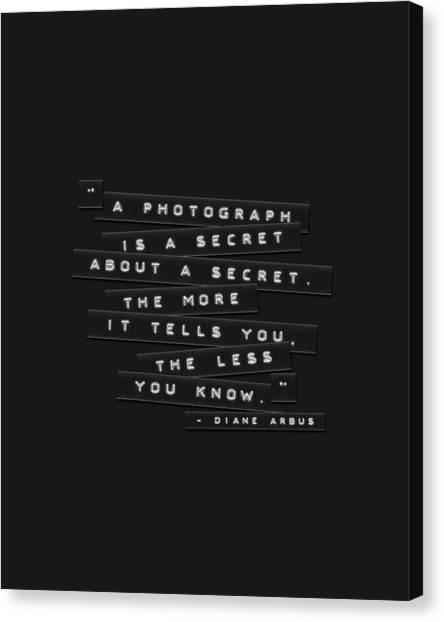 A Photograph Is A Secret Embossed Labels Canvas Print