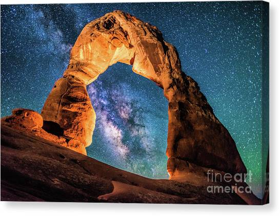 A Portal To The Milky Way At Delicate Arch Canvas Print